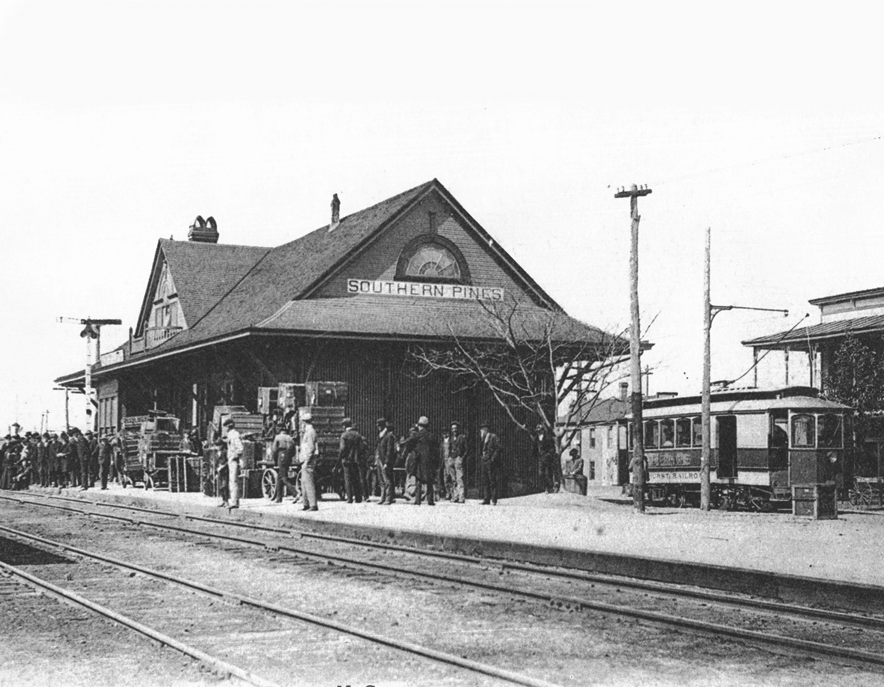 A permanent railway depot was built in 1898 that exists to the present. The Southern Pines-Pinehurst trolley also seen here operated from 1896-1905.